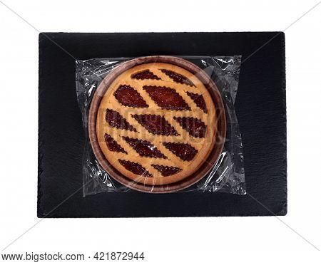 Strawberry jam pie. Round Big Jam Pie. Packaged cake in a transparent bag