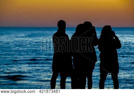 People At Beach Sunset Silhouette Scene