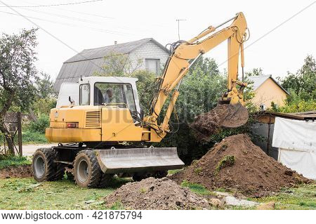 A Bulldozer Is Digging On Outdoors In An Industrial Area. Excavation. Belarus, Minsk Region - August