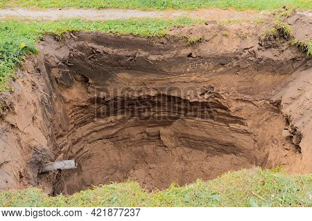 Deep Pit In The Ground For Home Sewers.