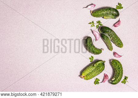 Trendy Ugly Organic Cucumbers, Garlic Cloves, Parsley Greens