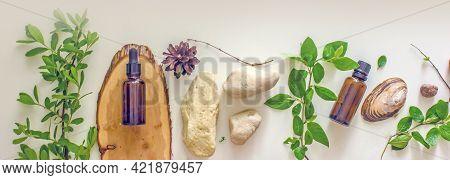 Organic Bio Herbal Cosmetics For Skin Care. Wellness Skin Care. Natural Cosmetic Oil, Stones, Branch