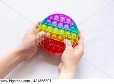 Colorful Anti-stress Pop It Toy With Round Shape And Hands. Develops Fine Motor Skills Of The Hands.