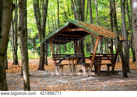 Gazebo With Table In A Public Park In Autumn.