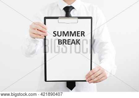 Man Hands Holding A White Sheet Tablet With The Text Summer Break Written In It
