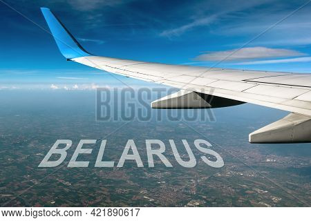 Belarus And Eu Conflict, Wing Of Plane Flying Above Belarus Territory. Concept Of Airplane Landing I