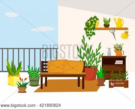 A Sofa On The Balcony And A Chest Of Drawers With Flowers. Home Garden On The Balcony With Flowers A