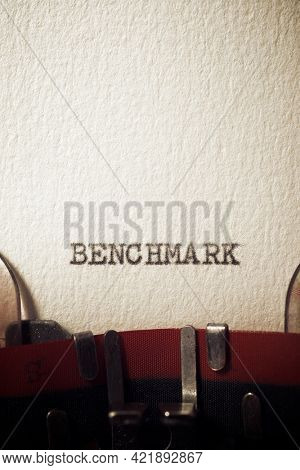 The word benchmark written with a typewriter.