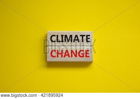 Climate Change Symbol. Wooden Blocks With Words 'climate Change' On Beautiful Yellow Background. Bus