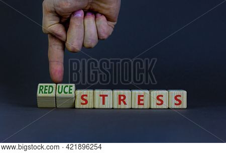 Reduce Stress Symbol. Businessman Turns Cubes And Changes Words 'stress' To 'reduce Stress'. Beautif