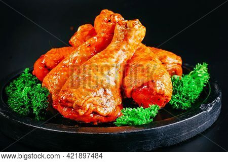 Raw Chicken Drumstick With Spices And Green Rosemary On A Black Background . Convenience Food,precoo