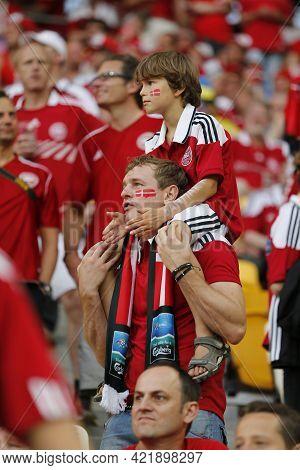 Lviv, Ukraine - June 17, 2012: Danish Football Fans Show Their Support During The Uefa Euro 2012 Gam