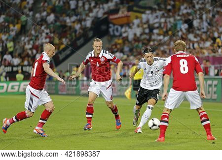 Lviv, Ukraine - June 17, 2012: Mesut Ozil Of Germany (in White) Fights For A Ball With Denmark Playe