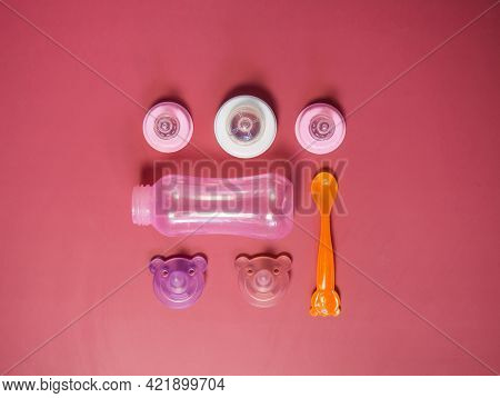 Baby Food Supplies, Various Bottles, Teats, Spoons And Plates.the Concept Of Baby Food And Child Car