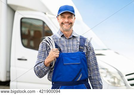 Technician Electrician Man With Cable Near Van