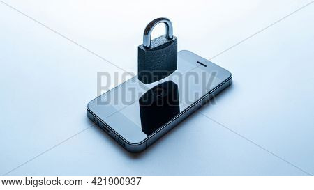 Security Protection. Modern Space Grey Mobile Phone With Padlock, Key On White Background. Smartphon