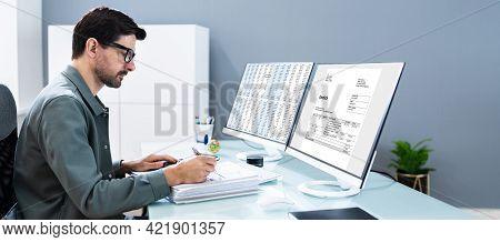 Accountant Using Finance E Invoice Software And Calculator