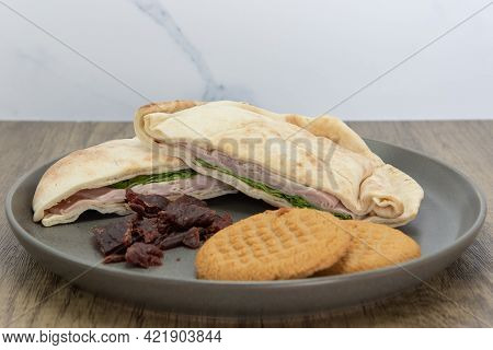 Pita Bread Ham Sandwich With Jerky And Cookies Is A Perfect Meal For A Quick Lunch Break At Work.