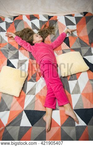 Tired Baby Relaxing. Pajamas And Clothes For Home. Pajamas And Bedroom Textile. Child Enjoy Leisure.