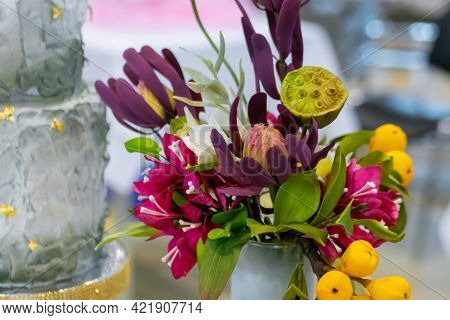 Colorful Composition Made Of Artificial Flowers And Yellow Pears At Studio, Flower Shop - Close Up.