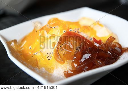 Bowl Of Aiyu Jelly Served On Shaved Ice, A Popular Cold Dessert In Singapore With Origins In Taiwan.