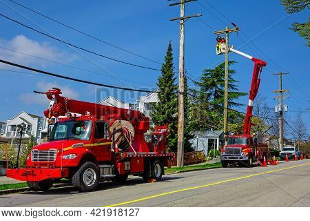 The Repair Team Works On The Power Transmission Line Poles And Carries Out Routine Repairs And Maint