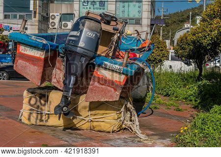 Sinjindo, South Korea; May 5, 2021: Small Fishing Boat With Outboard Engine Dry Docked On Large Foam