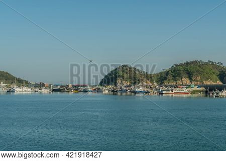 Sinjindo, South Korea; May 5, 2021: Seascape Of Seaport Harbor With Trawlers Moored To Piers.