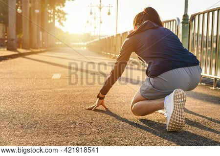 Back View Of Athlete Runner Woman In Start Position Ready For Sprint Or Running. Running Can Signifi