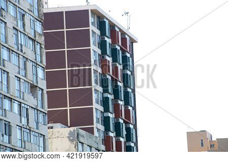 Upward View Of Tall Multicoloured Residential Buildings