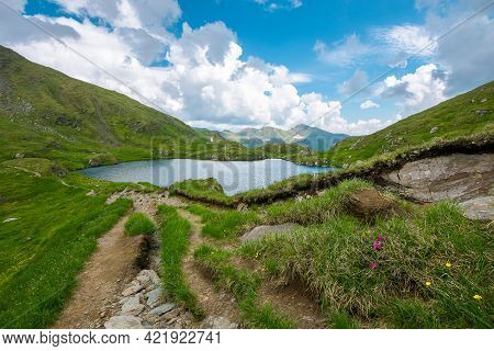 Landscape With Lake In Mountains. Wonderful Summer Nature Scenery On A Cloudy Day. Popular Travel De