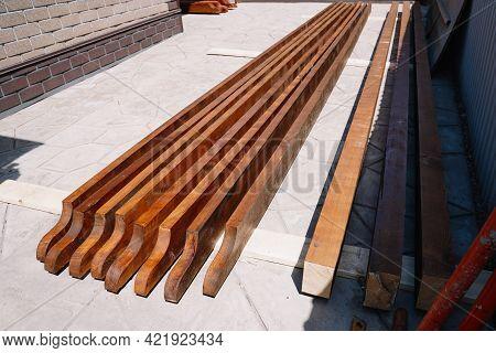 Blanks For The Construction Of A Pergola Gazebo Near The House Against