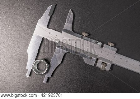 Caliper Is A Highly Accurate Measurement Tool. The Exact Size Of The Parts. Professional Tool