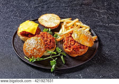 Bbq Sloppy Joe Sandwiches With French Fries On A Black Plate, American Cuisine