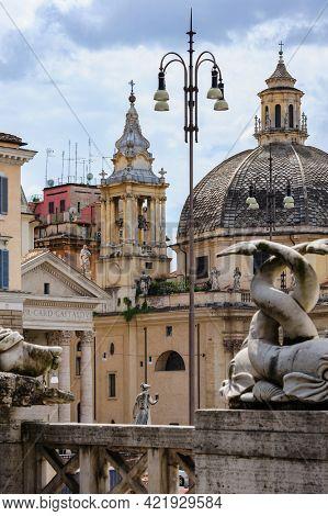 Rome, Italy, August 2014: Rooftops and domes by piazza del Popolo in Rome, Santa Maria in Montesanto and Santa Maria dei Miracoli basilics