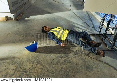 Asian Electrician Worker Accident Electric Shock Unconscious In Site Work. First Aid Maintenance Wor