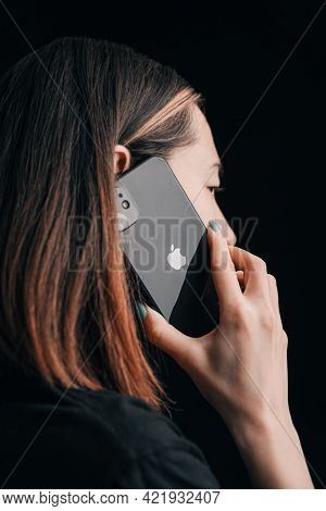 Gelendzhik, Russia, 24 March 2021: The Young Woman Is Talking On The Iphone 11. The Apple Logo Is De