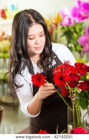Friendly Asian florist or Saleswoman in a flower shop