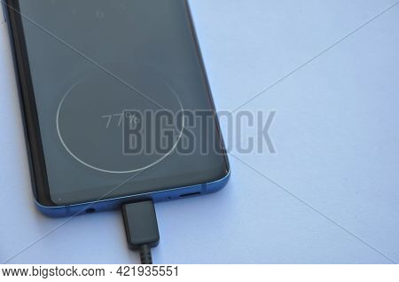 Overhead View Of A Smartphone Connected With Usb Type-c Charging Cable With Negative Space, Mobile P