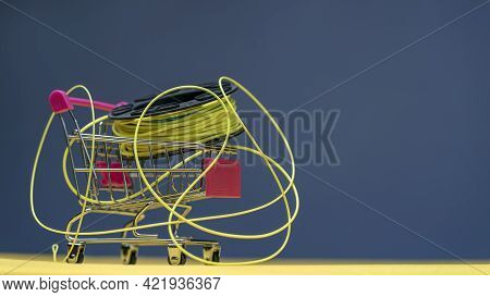 Fly Fishing Reel With A Line In A Mini Trolley. Fly Fishing Shopping Concept.