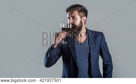 Sommelier, Degustator With Glass Of Wine, Winery, Male Winemaker. Man Holding Glass Of Champagne In