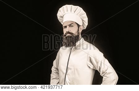 Cook Hat. Serious Cook In White Uniform, Chef Hat. Portrait Of A Serious Chef Cook