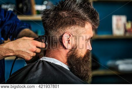 Man Visiting Hairstylist In Barbershop. Barber Works With Hair Clipper. Hipster Client Getting Hairc
