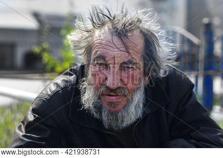 Man Hommeless, Vagrant Beggar On Street City. Surgut, Russia - 25, May 2021.