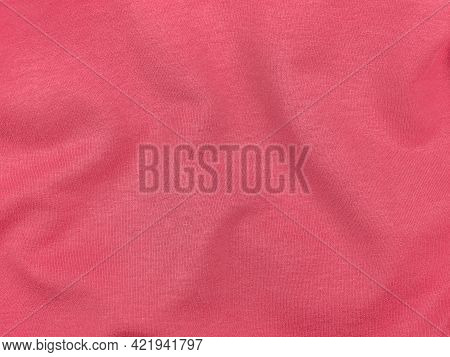 Pink Jersey Fabric Matte Texture Top View. Red Coral Knitwear Satin Background. Fashion Color Femini