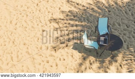 Top View Of Table With Laptop On Beach Sand And Palm Tree Shadow. Digital Nomad. 3d Render