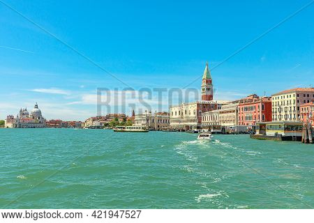 Venice, Italy - May 9, 2021: San Marco Bell Tower In San Marco Square In Venice With Saint Mark Basi