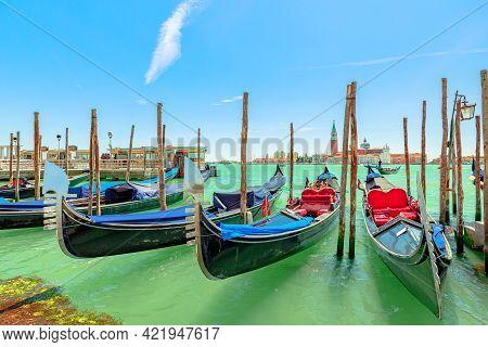 Venice Historic Gondolas Boats Reflected On Sea Of The City Giudecca Canal. San Giorgio Maggiore Chu