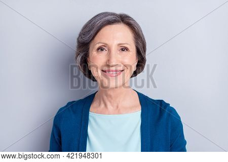 Portrait Of Attractive Cheerful Middle-aged Woman Wearing Blue Cardigan Isolated Over Grey Color Bac