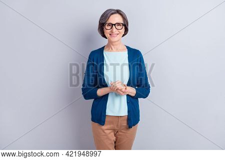 Photo Of Charming Shiny Age Woman Wear Blue Cardigan Glasses Arms Together Smiling Isolated Green Co